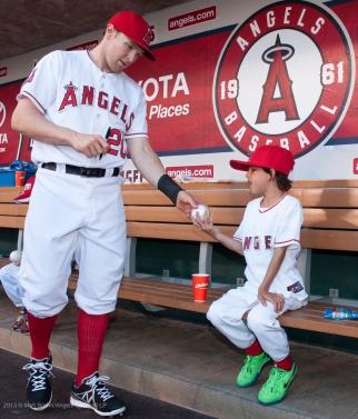 Brendan Harris #20 signs honorary Bat Kid, Arya Emadi's baseball. Photo by Matt Brown/Angels Baseball LP