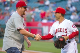 Elis Koudsi is congratulated by Third Base Coach Dino Ebel after throwing the first pitch. Photo by Matt Brown/Angels Baseball LP