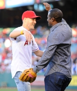 Former Angels player, Tony Phillips congratulates Officer Alex Collins after the first pitch. Photo by Matt Brown/Angels Baseball LP