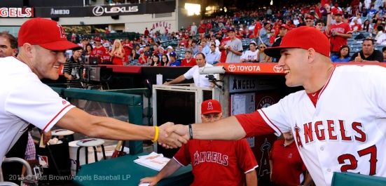 Officer Alex Collins is congratulated by Mike Trout #27 after his pitch. Photo by Matt Brown/Angels Baseball LP