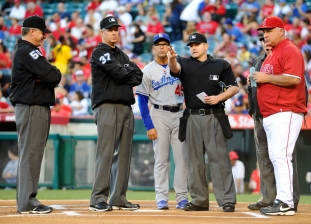 Manager Mike Scioscia at the plate with tonights officials. Photo by Matt Brown/Angels Baseball LP