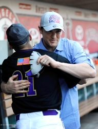 Brendan Harris hugs a player in the Purple Heart baseball game on Armed Forces Day at Angel Stadium. Photo by Matt Brown/Angels Baseball LP