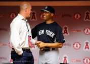 Mariano Rivera shakes hands with former Angels pitcher Jim Abbott during a special meet and greet session with members of the Angels organization before the game. Photo by Matt Brown/Angels Baseball LP