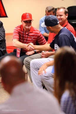 Angels Certified Athletic Trainer Rick Smith shakes hands with Mariano Rivera during a special meet and greet session with members of the Angels organization before the game. Photo by Matt Brown/Angels Baseball LP