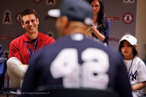 Angels General Manager Jerry Dipoto smiles while listening to Mariano Rivera during a special meet and greet session with members of the Angels organization before the game. Photo by Matt Brown/Angels Baseball LP