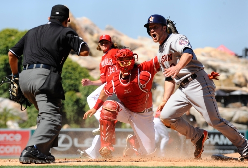 Houston's Trevor Crowe reacts after being called out on a tag by Hank Conger #16 who made the catch from pitcher Garrett Richards #43 in the ninth inning. Photo by Matt Brown/Angels Baseball LP