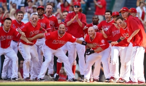 Mark Trumbo #44 at bat. Walk off home run. Team celebrate home plate. Photo by Matt Brown/Angels Baseball LP