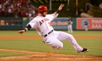 Josh Hamilton #32 sliding, play at the plate. Photo by Matt Brown/Angels Baseball LP