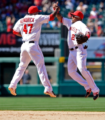 Howard Kendrick #47, Erick Aybar #2 celebrating, high five, jumping. JMG. Photo by Matt Brown/Angels Baseball LP
