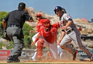 Hank Conger #16 catching, tagging, play at the plate. Garrett Richards #43. Photo by Matt Brown/Angels Baseball LP