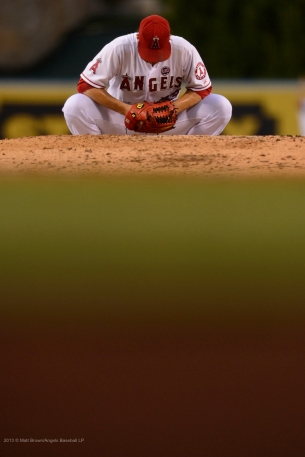 C.J. Wilson #33 kneelings, crouching behind mound. Photo by Matt Brown/Angels Baseball LP