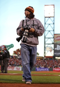 SAN FRANCISCO - OCTOBER 7:  Team photographer Andy Kuno of the San Francisco Giants works before Game 2 of the NLDS against the Cincinnati Reds at AT&T Park on October 7, 2012 in San Francisco, California. (Photo by Brad Mangin)